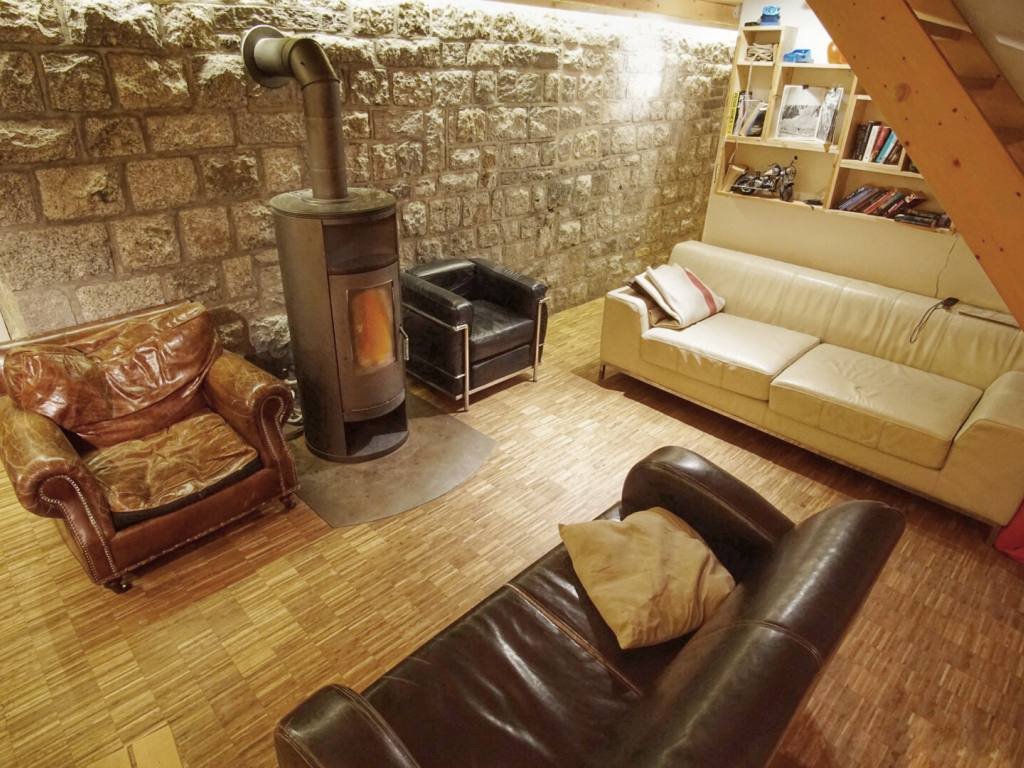 Relax next to the wood stove in our lodge