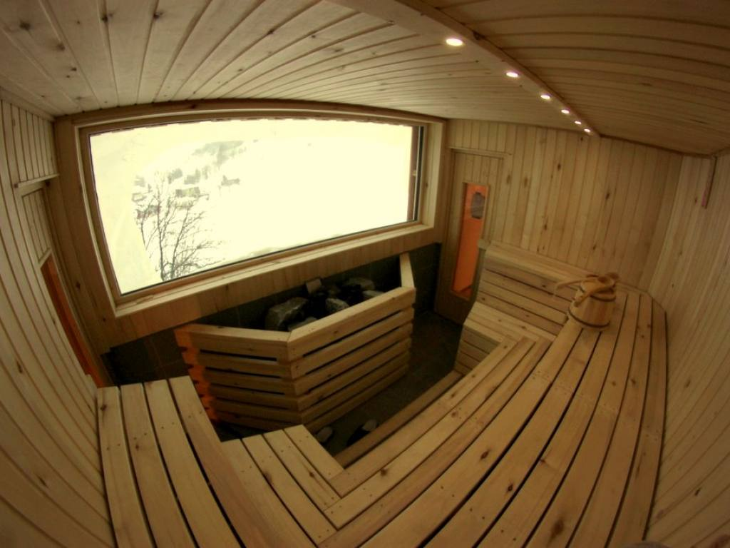 Sauna with panorama view  at the Basecamp Andermatt. Lodge and Hostel for cheap